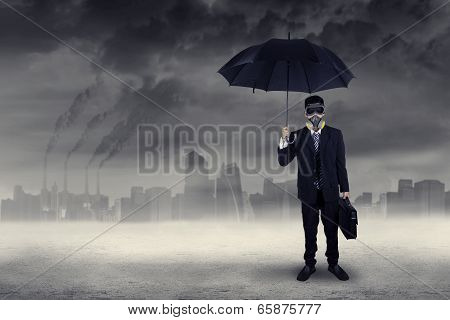 Businessman Standing Outdoors Under Air Pollution