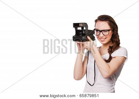 modern young woman in glasses and a Polaroid