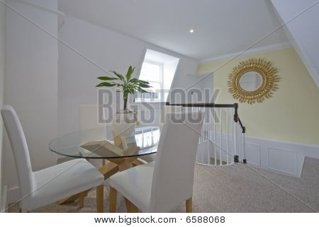 Luxury Dining Room With Round Glass Table White Chairs And A Flower