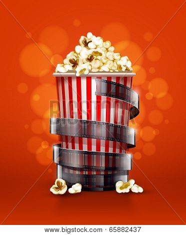 cinema concept with paper bucket with popcorn and movie film tape. Eps10 vector illustration.