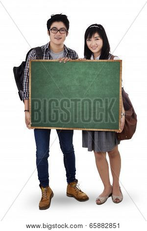 Two Student Holding Empty Blackboard