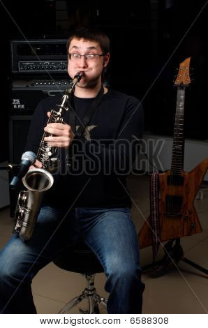 Male Play In Study On Saxophone