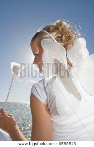 Girl In White Dress On A Beach