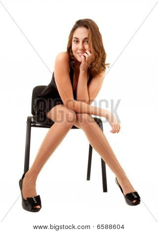 Women In Black Dress On Chair