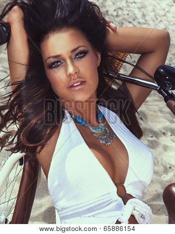 Sexy Brunette Lady On Sandy Beach Posing