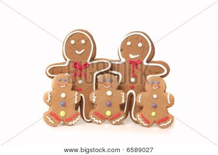 Five Gingerbread People Against A White Background