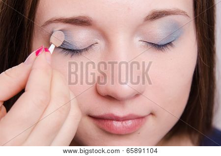 Makeup Artist Applies Eye Shadow Model