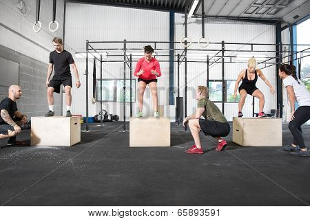 group trains box jump
