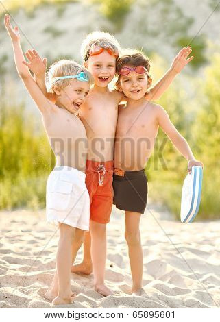 Portrait Of Children On The Beach In Summer