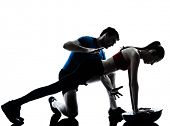 stock photo of abdominal  - personal trainer man coach and woman exercising abdominals push ups on bosu silhouette studio isolated on white background - JPG