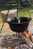 stock photo of cauldron  - healthy cooking on ancient traditional big metal pot  - JPG