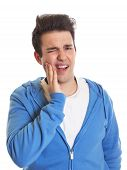 foto of toothache  - Young hispanic guy with toothache on an isolated white background - JPG