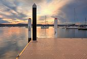 stock photo of pontoon boat  - Boats and yachts moored at sunset from New Brighton Public Wharf Saratoga NSW Australia - JPG