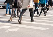 stock photo of pedestrians  - pedestrians cross the street at the crossroads - JPG
