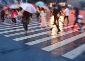 image of rainy day  - crowds of people crossing the street on a rainy day in the city - JPG