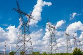 stock photo of transmission lines  - Pylon and transmission power line in summer day - JPG