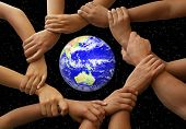 stock photo of joining hands  - Hands framing the earth in a global team theme - JPG