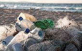stock photo of plastic bottle  - Beach pollution - JPG