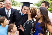 stock photo of hispanic  - Hispanic Student And Family Celebrating Graduation - JPG