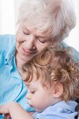 picture of grandma  - Vertical view of grandma and her grandchild - JPG