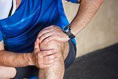 stock photo of joint  - Male runner having problems in knee joint - JPG