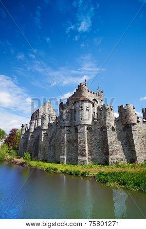 Gravensteen castle reflecting in river, Belgium