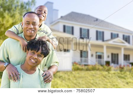 Happy Attractive African American Family in Front of Beautiful House.