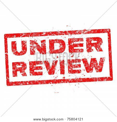 Under Review Red Rubber Stamp Vector Over A White Background.