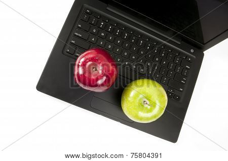 Two Apples On A Laptop