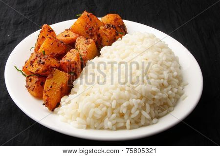 Cooked white Rice with fried potato.