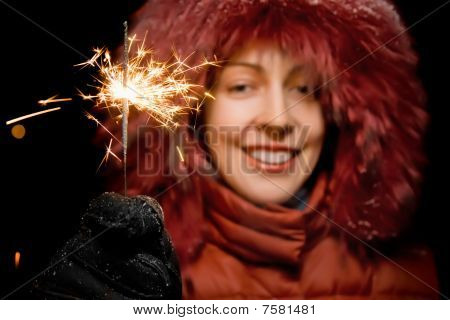 Beautiful Smiling Young Woman With Bengal Fire In Hand Isolated