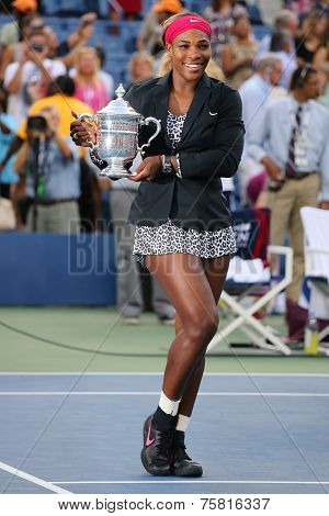 Eighteen times Grand Slam champion and US Open 2014 champion Serena Williams holding US Open trophy