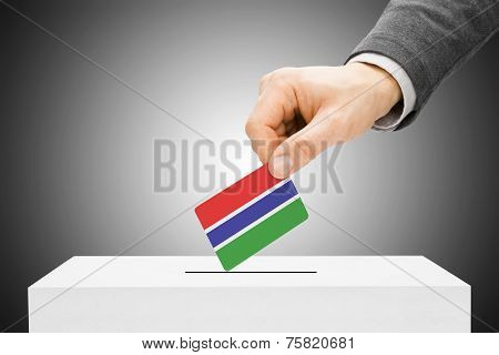 Voting Concept - Male Inserting Flag Into Ballot Box - Gambia