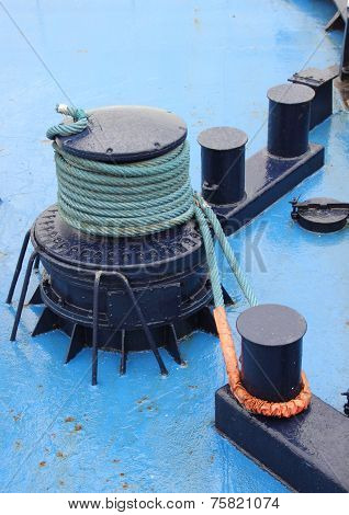 Anchor Winch With Rope On Blue Ship Deck