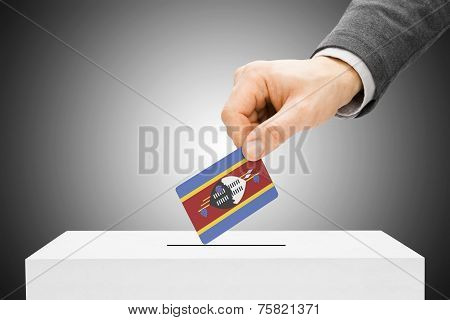 Voting Concept - Male Inserting Flag Into Ballot Box - Swaziland