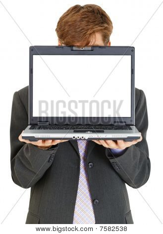 Businessman Hiding Behind Computer Screen