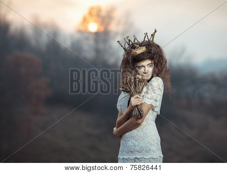 Young Girl In A White Lace Dress, A Crown Of Twigs With A Bouquet Of Dried Flowers