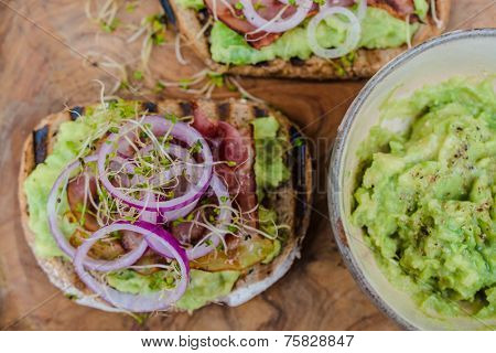 Sandwich with fresh salad and avocado
