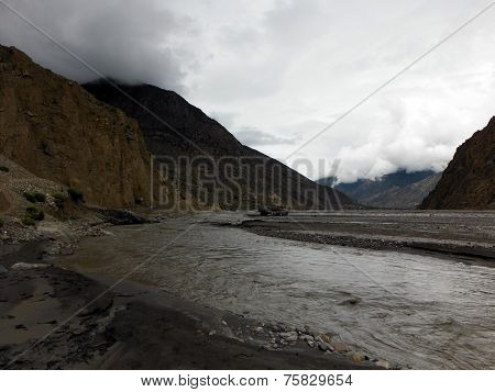 Truck In A Himalayan Riverbed During Monsoon