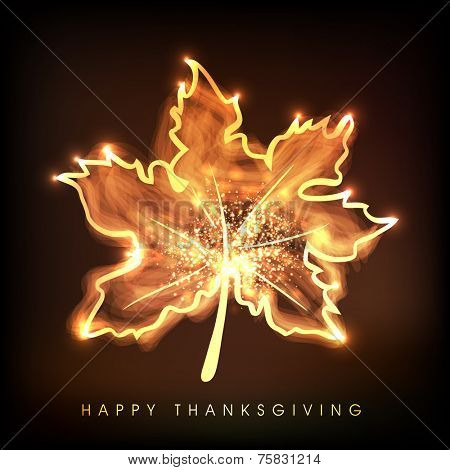 Shiny golden maple leaf with stylish text for Thanksgiving Day celebration.