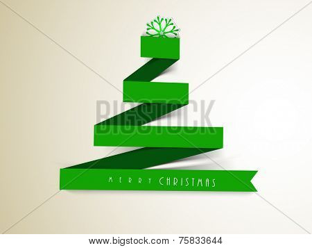 Merry Christmas greeting card decorated with stylish paper X-mas tree and snowflake on grey background.