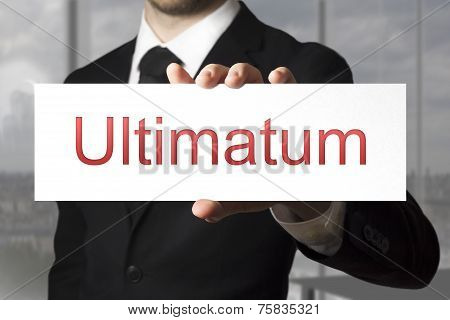 Businessman Holding Sign Ultimatum