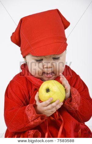 Baby Girl Holding And Caress An Apple