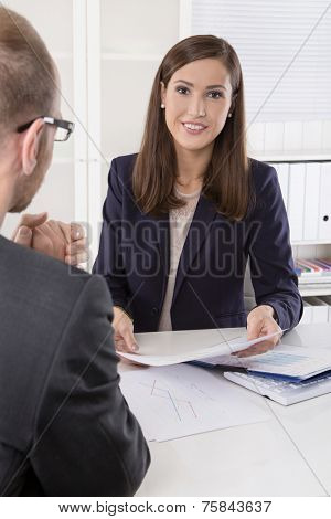 Customer and agent sitting at desk in a meeting or successful collaboration under man and woman in the office.