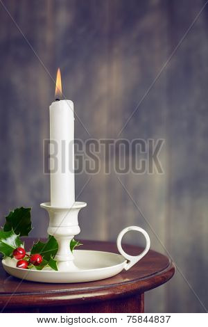 Christmas candle with holly and berries