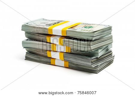 Creative business finance making money concept - stack of bundles of 100 US dollars 2013 edition banknotes (bills) isolated on white