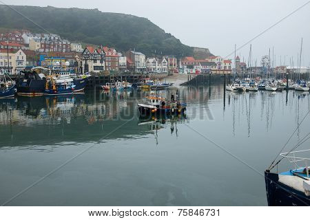 Small fishing boat entering Scarborough harbour