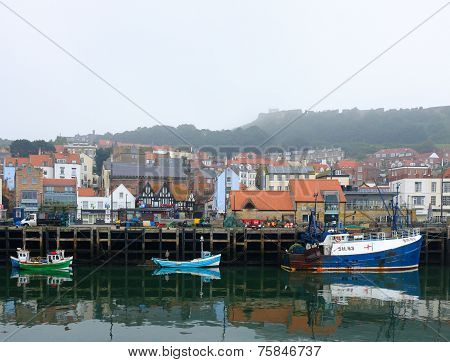 Three fishing boats in Scarborough harbour