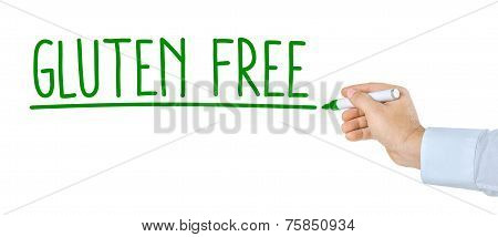 Hand with pen on a white background writing Gluten Free