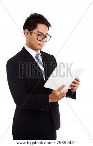 Asian Businessman Read A Book